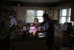 With use of a generator Ed and Nancy Schueren make dinner as they cope with no power and water after high winds and water from Hurricane Florence hit Swansboro N.C., Friday, Sept. 14, 2018. (AP Photo/Tom Copeland)