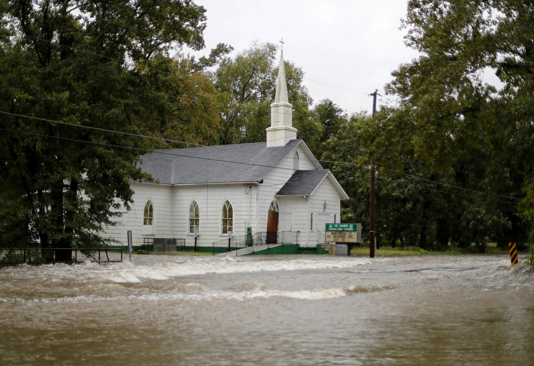 A church flooded by Hurricane Matthew two years ago is surrounded by rushing water as Florence continues to dump heavy rain in Fayetteville, N.C., Sunday, Sept. 16, 2018. (AP Photo/David Goldman)