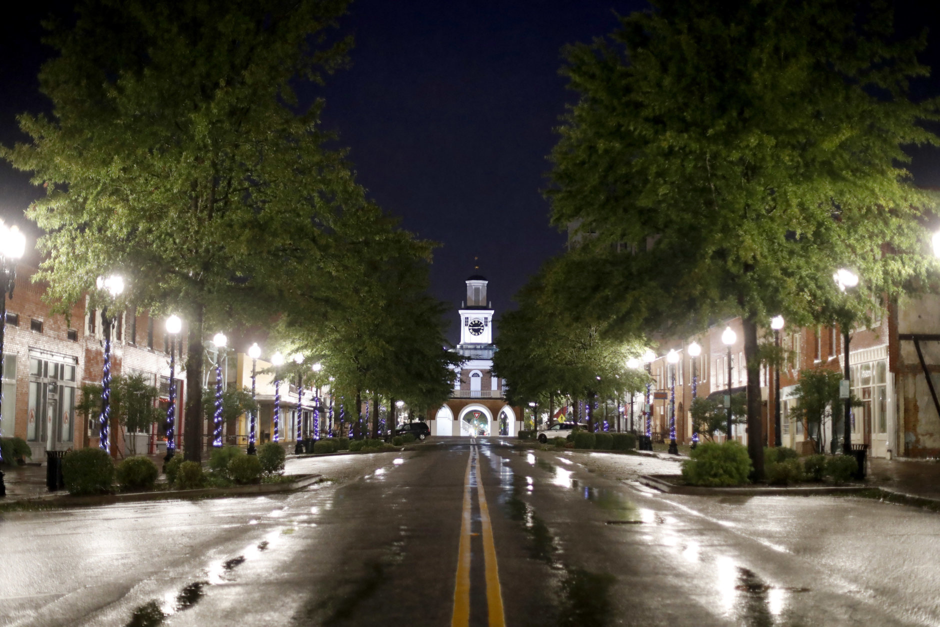 A downtown street sits empty under a citywide curfew as the threat of additional flooding from Florence remains, in Fayetteville, N.C., Sunday, Sept. 16, 2018. (AP Photo/David Goldman)