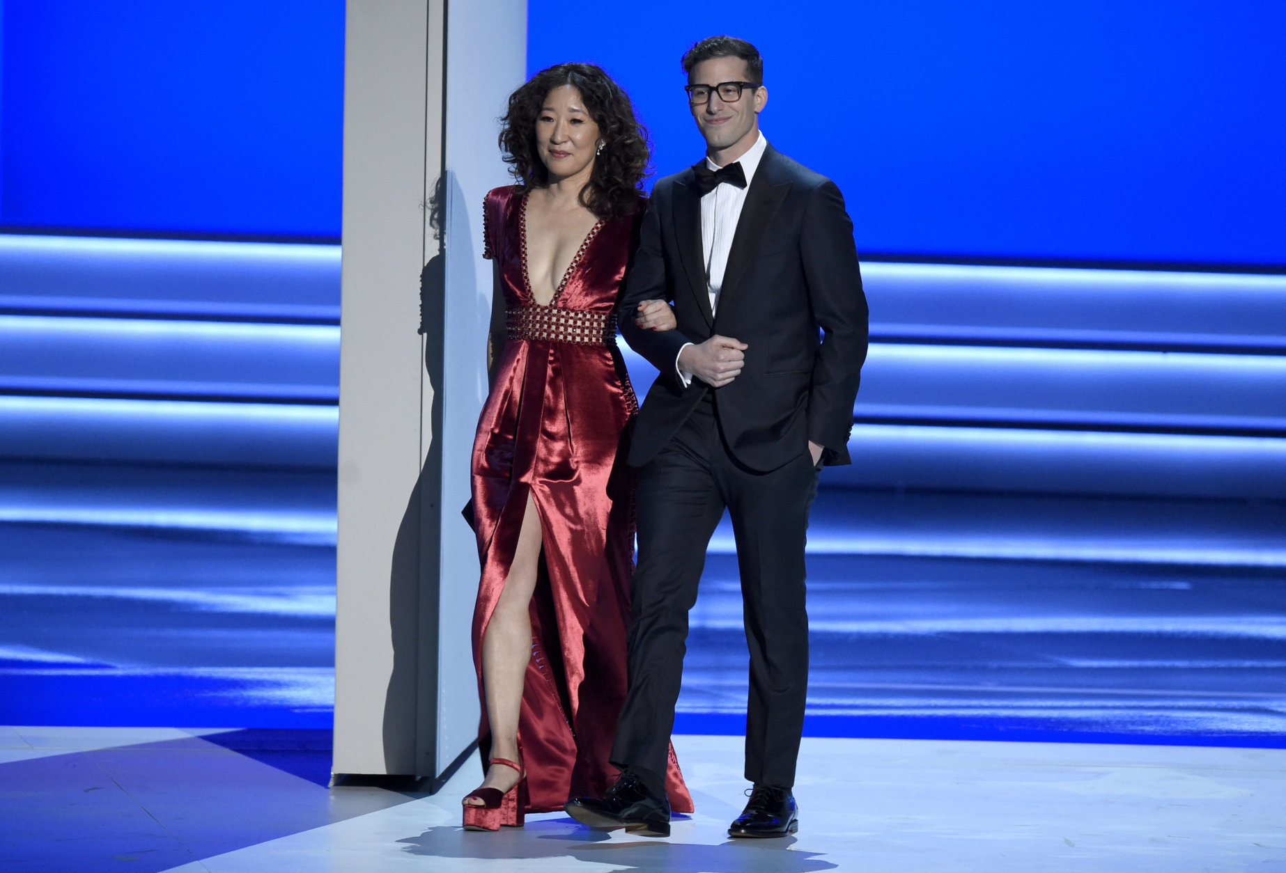 Sandra Oh, left, and Andy Samberg appear on stage to present the award for outstanding directing for a comedy series at the 70th Primetime Emmy Awards on Monday, Sept. 17, 2018, at the Microsoft Theater in Los Angeles. (Photo by Chris Pizzello/Invision/AP)
