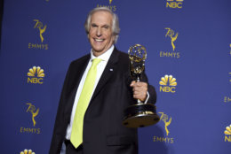 """Henry Winkler poses in the press room with the award for outstanding supporting actor in a comedy series for """"Barry"""" at the 70th Primetime Emmy Awards on Monday, Sept. 17, 2018, at the Microsoft Theater in Los Angeles. (Photo by Jordan Strauss/Invision/AP)"""