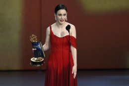 """Rachel Brosnahan accepts the award for outstanding lead actress in a comedy series for """"The Marvelous Mrs. Maisel"""" at the 70th Primetime Emmy Awards on Monday, Sept. 17, 2018, at the Microsoft Theater in Los Angeles. (Photo by Chris Pizzello/Invision/AP)"""