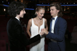 IMAGE DISTRIBUTED FOR THE TELEVISION ACADEMY - Finn Wolfhard, Maika Monroe and Joe Keery at the 70th Primetime Emmy Awards on Monday, Sept. 17, 2018, at the Microsoft Theater in Los Angeles. (Photo by Alex Berliner/Invision for the Television Academy/AP Images)