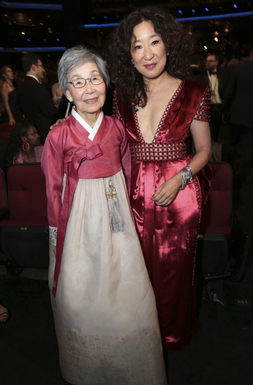 IMAGE DISTRIBUTED FOR THE TELEVISION ACADEMY - Sandra Oh, right, and her mother, Young-Nam Oh, at the 70th Primetime Emmy Awards on Monday, Sept. 17, 2018, at the Microsoft Theater in Los Angeles. (Photo by Alex Berliner/Invision for the Television Academy/AP Images)