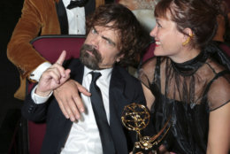 IMAGE DISTRIBUTED FOR THE TELEVISION ACADEMY - Nikolaj Coster-Waldu, Peter Dinklage and Erica Schmidt at the 70th Primetime Emmy Awards on Monday, Sept. 17, 2018, at the Microsoft Theater in Los Angeles. (Photo by Alex Berliner/Invision for the Television Academy/AP Images)