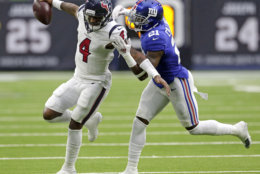 Houston Texans quarterback Deshaun Watson (4) is tackled by New York Giants defensive back Landon Collins (21) during the first half of an NFL football game Sunday, Sept. 23, 2018, in Houston. (AP Photo/Michael Wyke)