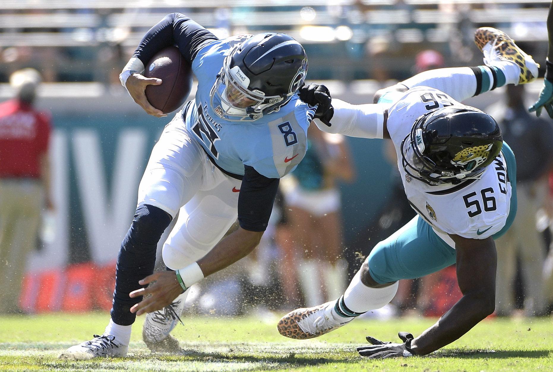 Jacksonville Jaguars defensive end Dante Fowler (56) tackles Tennessee Titans quarterback Marcus Mariota (8) during the second half of an NFL football game, Sunday, Sept. 23, 2018, in Jacksonville, Fla. (AP Photo/Phelan M. Ebenhack)