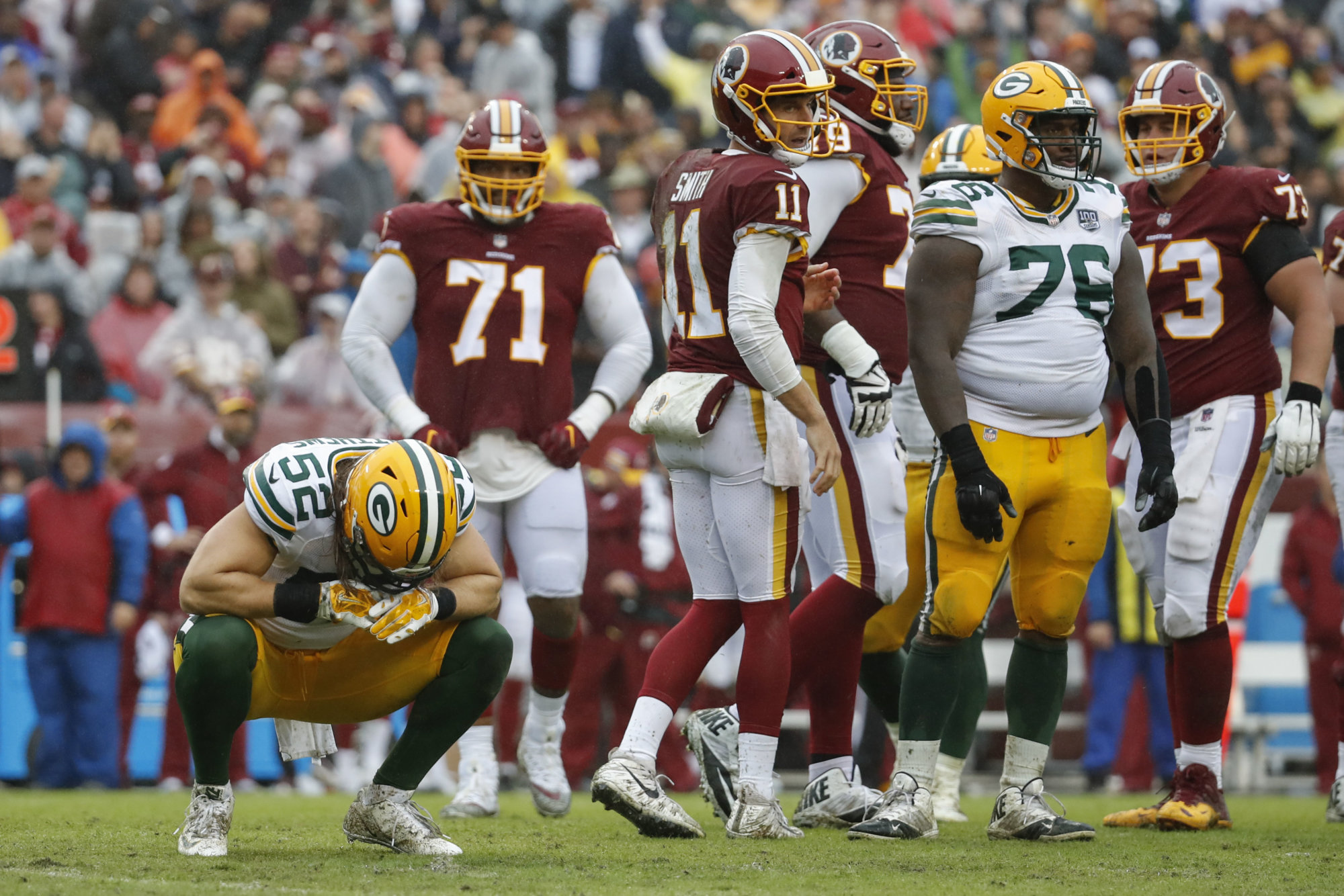 Green Bay Packers linebacker Clay Matthews (52) reacts after his penalty for roughing the passer during the second half of an NFL football game against the Washington Redskins, Sunday, Sept. 23, 2018 in Landover, Md. (AP Photo/Alex Brandon)