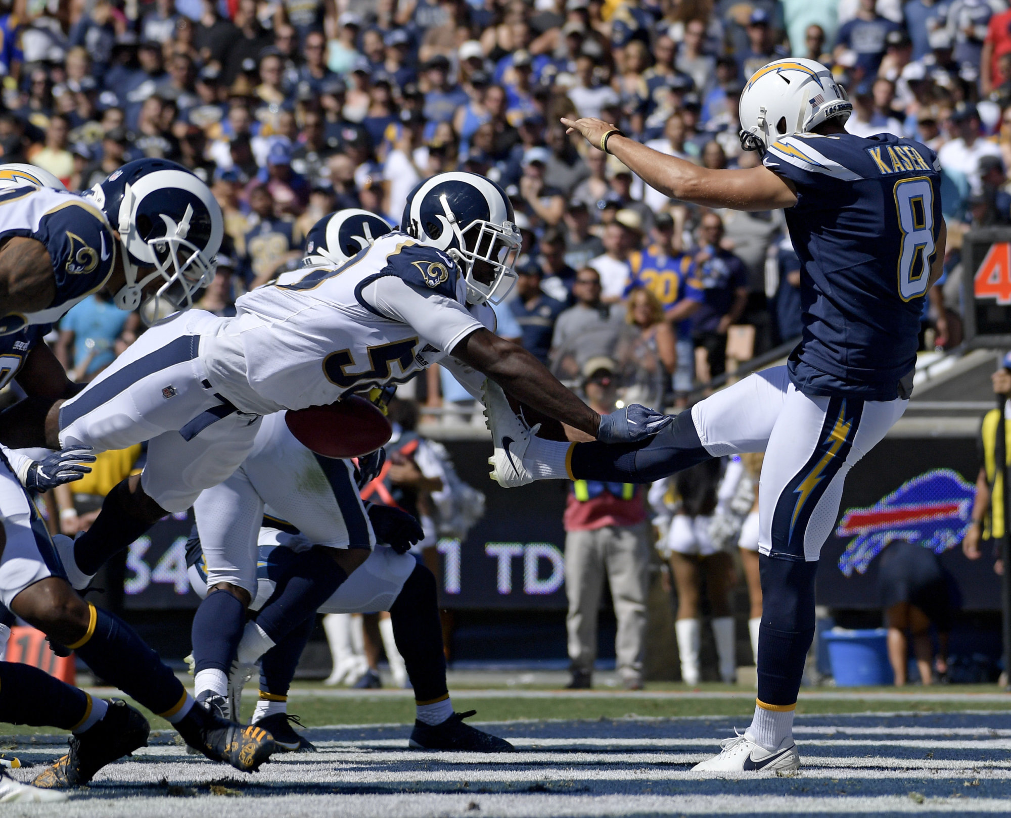 Los Angeles Rams linebacker Cory Littleton blocks a punt by Los Angeles Chargers punter Drew Kaser in the end zone during the first half in an NFL football game Sunday, Sept. 23, 2018, in Los Angeles. (AP Photo/Mark J. Terrill)