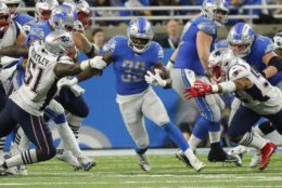 Detroit Lions running back Kerryon Johnson (33) breaks through the New England Patriots line during the second half of an NFL football game, Sunday, Sept. 23, 2018, in Detroit. (AP Photo/Rick Osentoski)