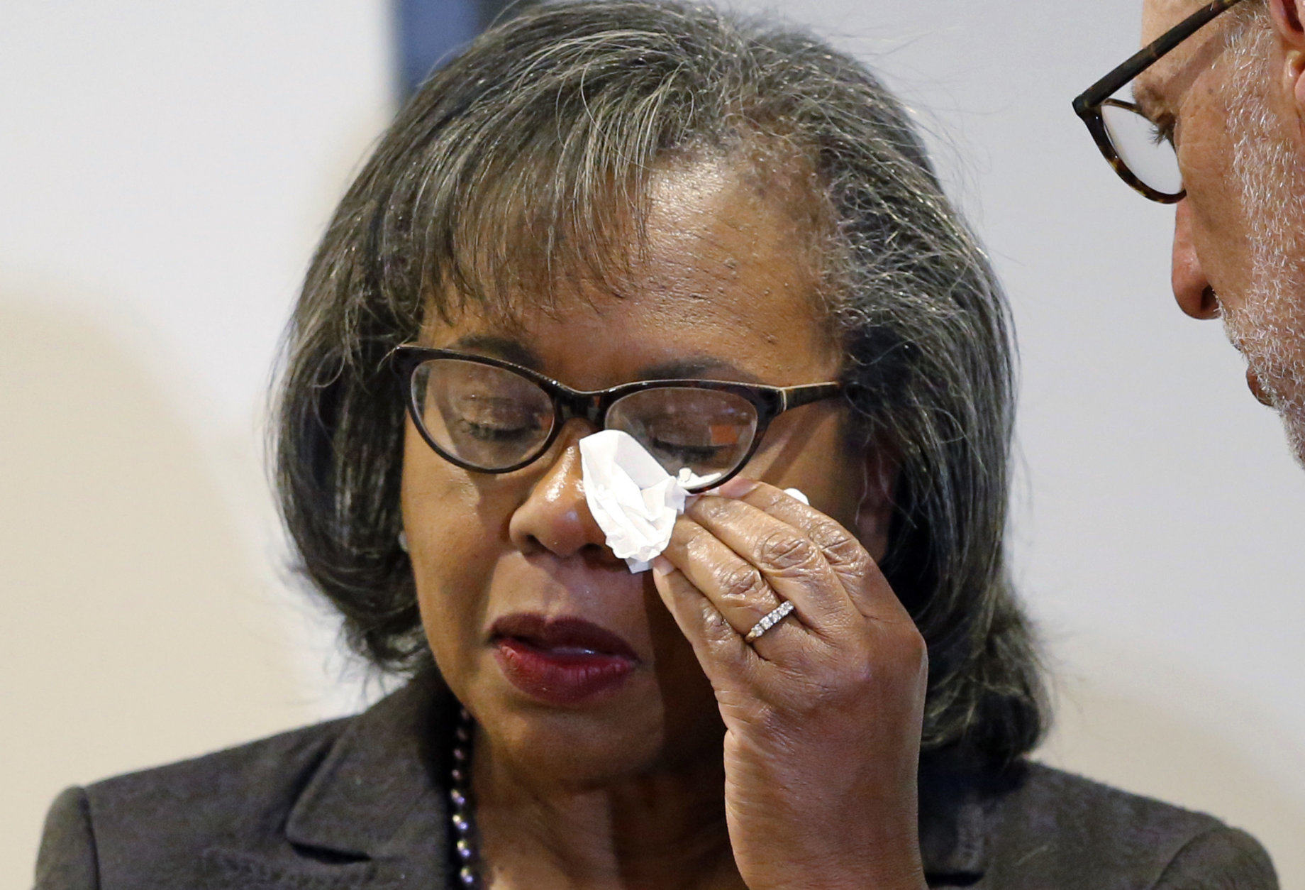 Anita Hill wipes her eye after speaking at the University of Utah on Wednesday, Sept. 26, 2018, in Salt Lake City. Hill has been back in the spotlight since Christine Blasey Ford accused Supreme Court nominee Brett Kavanaugh of sexually assaulting her when the two were in high school. Hill's 1991 testimony against Clarence Thomas riveted the nation. Thomas was confirmed anyway, but the hearing ushered in a new awareness of sexual harassment. (AP Photo/Rick Bowmer)