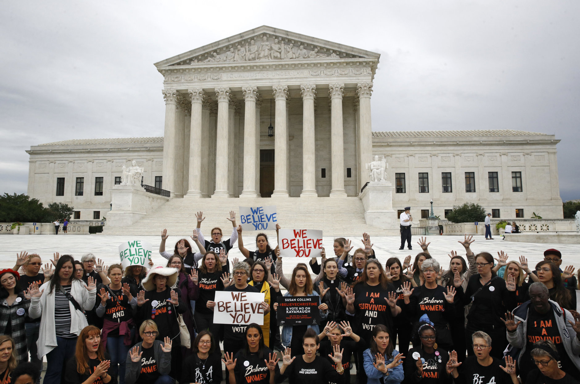 Protesters gather in front of the Supreme Court on Capitol Hill in Washington, Thursday, Sept. 27, 2018. The Senate Judiciary Committee is scheduled to hear Thursday from Supreme Court nominee Brett Kavanaugh and Christine Blasey Ford, the woman who says he sexually assaulted her. (AP Photo/Patrick Semansky)