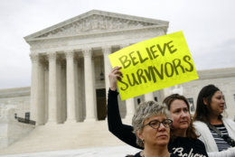 Protesters gather in front of the Supreme Court on Capitol Hill in Washington, Thursday, Sept. 27, 2018. The Senate Judiciary Committee is scheduled to hear from Supreme Court nominee Brett Kavanaugh and Christine Blasey Ford, the woman who says he sexually assaulted her. (AP Photo/Patrick Semansky)