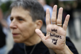 A protesterdisplays a message in support of sexual assault survivors on her palm in front of the Supreme Court on Capitol Hill in Washington, Thursday, Sept. 27, 2018. The Senate Judiciary Committee is scheduled to hear from Supreme Court nominee Brett Kavanaugh and Christine Blasey Ford, the woman who says he sexually assaulted her. (AP Photo/Patrick Semansky)