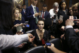 Actress Alyssa Milano talks to the media after she arrived for the Senate Judiciary hearing on Capitol Hill in Washington, Thursday, Sept. 27, 2018. with Christine Blasey Ford and Supreme Court nominee Brett Kavanaugh. (Michael Reynolds/Pool Photo via AP)