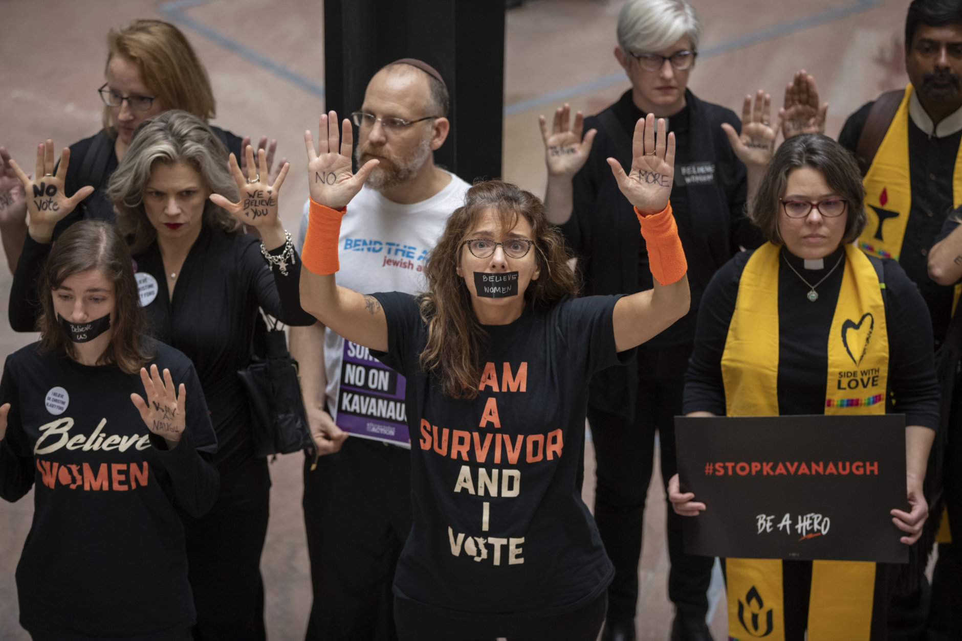 Protesters demonstrate in the Hart Senate Office Building as the Senate Judiciary Committee hears from Supreme Court nominee Brett Kavanaugh and Christine Blasey Ford on Capitol Hill in Washington, Thursday, Sept. 27, 2018. (AP Photo/J. Scott Applewhite)
