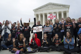 Women supporters of Christine Blasey Ford demonstrate in front of the Supreme Court in Washington, Thursday, Sept. 27, 2018. The Senate Judiciary Committee will hold a hearing today with Supreme Court Nominee Brett Kavanaugh and Christine Blasey Ford, the woman who says he sexually assaulted her. (AP Photo/Cliff Owen)