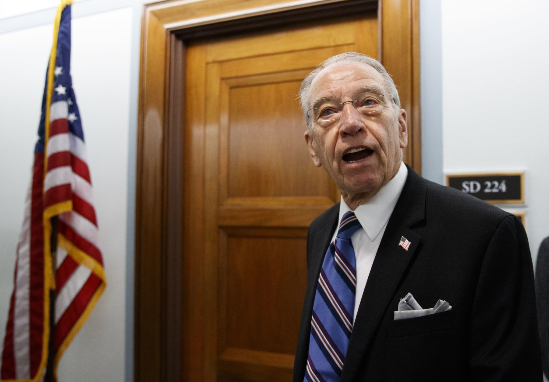 Senate Judiciary Committee chairman Chuck Grassley, R-Iowa, pauses to speak to reporters as he arrives for the Senate Judiciary hearing on Capitol Hill in Washington, Thursday, Sept. 27, 2018, with Christine Blasey Ford and Supreme Court nominee Brett Kavanaugh. (AP Photo/Carolyn Kaster)