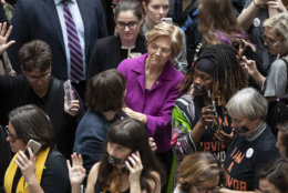 Sen. Elizabeth Warren, D-Mass., a vocal critic of Supreme Court nominee Brett Kavanaugh over the sexual harassment allegations made against him, greets womens' rights activists in the Hart Senate Office Building as the Senate Judiciary Committee hears from Kavanaugh and Christine Blasey Ford, his accuser, on Capitol Hill in Washington, Thursday, Sept. 27, 2018. (AP Photo/J. Scott Applewhite)