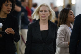 Sen. Kirsten Gillibrand, D-N.Y., walks outside the hearing room during a break in a Senate Judiciary Committee hearing on Capitol Hill in Washington, Thursday, Sept. 27, 2018, with Christine Blasey Ford and Supreme Court nominee Brett Kavanaugh. (AP Photo/Carolyn Kaster)