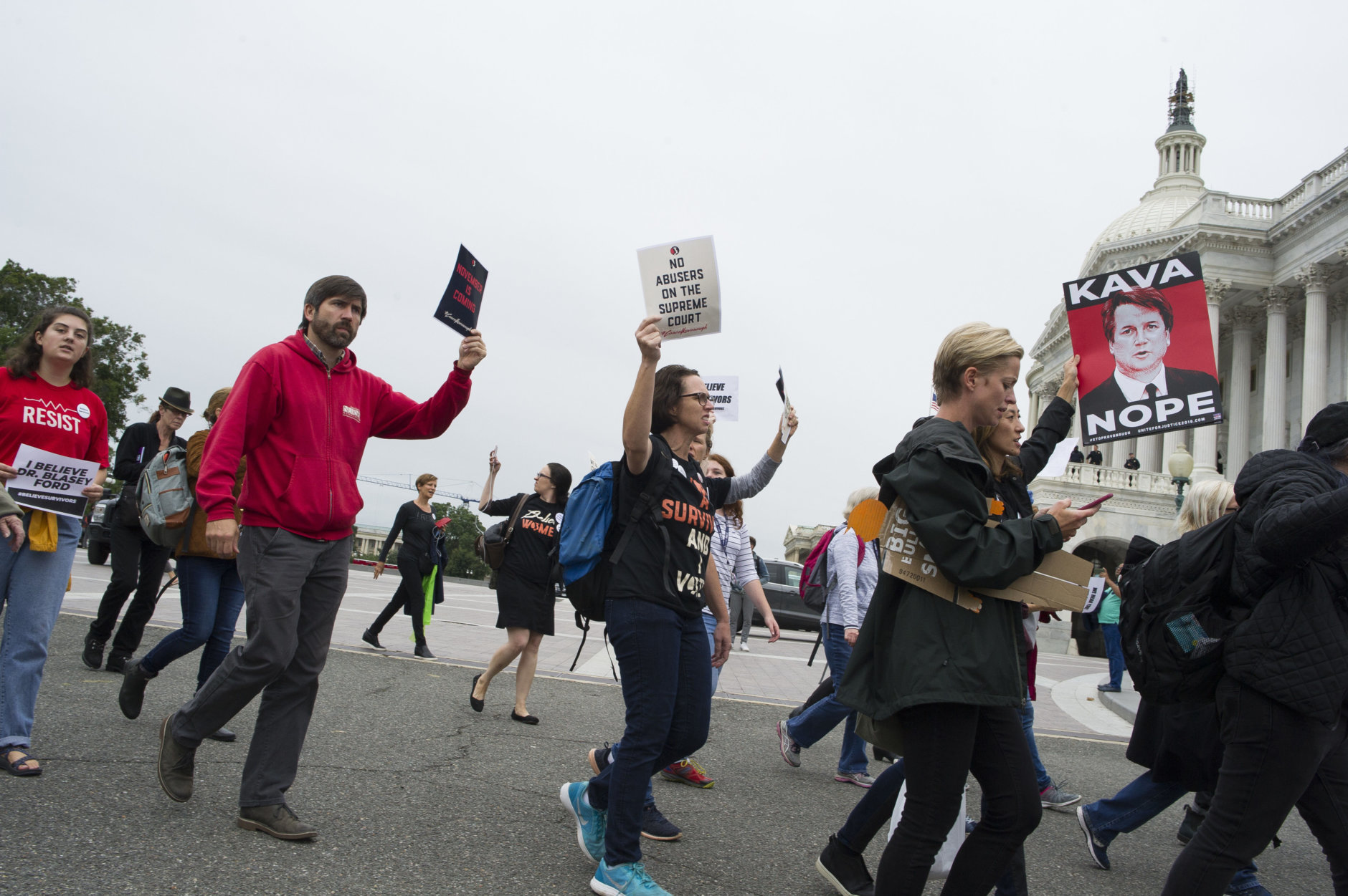 Supporters of Christine Blasey Ford parade past the Capitol in Washington, Thursday, Sept. 27, 2018. T (AP Photo/Cliff Owen)
