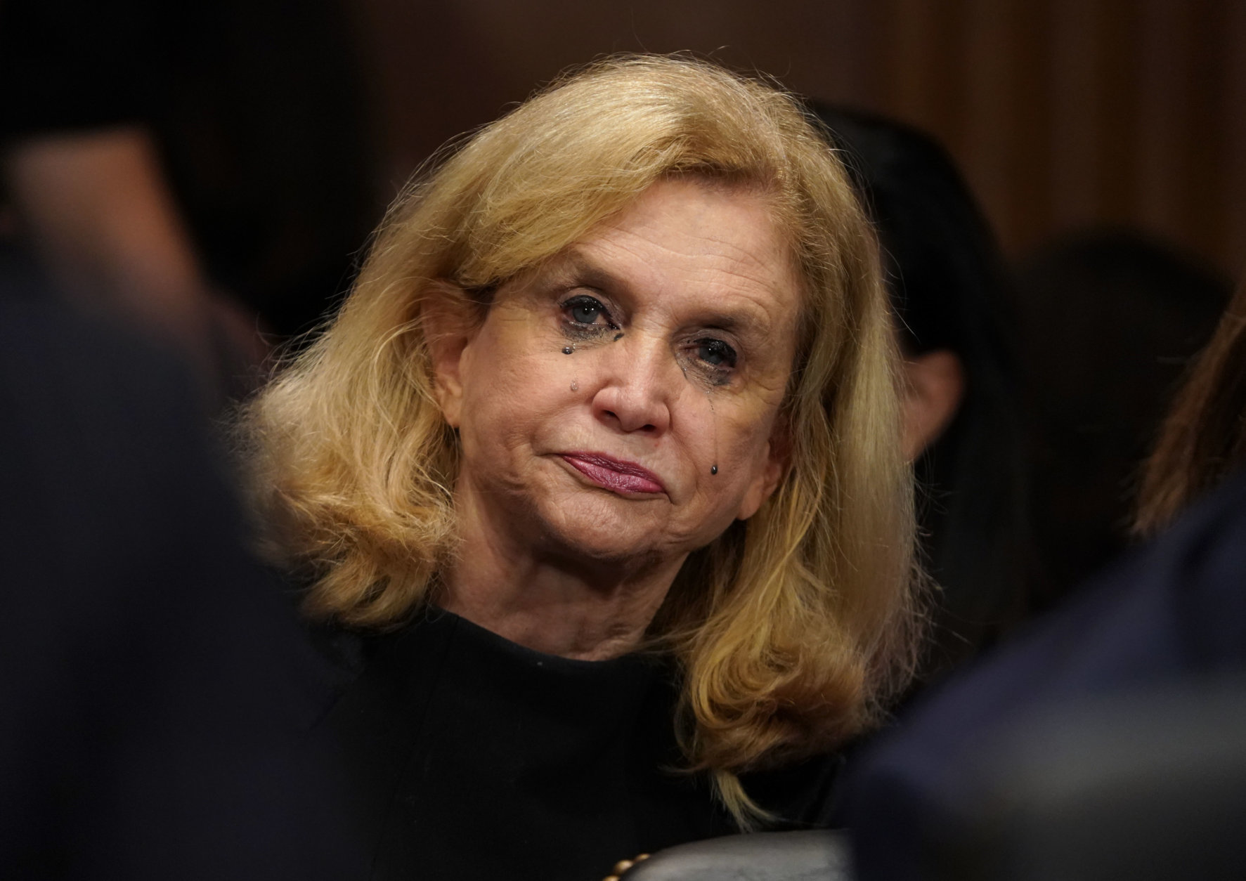 Rep. Carolyn Maloney, D-N.Y., cries as Christine Blasey Ford testifies before the Senate Judiciary Committee on Capitol Hill in Washington, Thursday, Sept. 27, 2018. (AP Photo/Andrew Harnik, Pool)