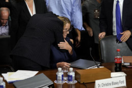 Christine Blasey Ford is hugged by her attorney Debra Katz after she finished testifying before the Senate Judiciary Committee on Capitol Hill in Washington, Thursday, Sept. 27, 2018. (AP Photo/Andrew Harnik, Pool)