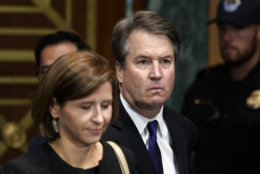 Judge Brett Kavanaugh arrives to testify with his wife Ashley Estes Kavanaugh before the Senate Judiciary Committee on Capitol Hill in Washington, Thursday, Sept. 27, 2018. (AP Photo/Andrew Harnik, Pool)