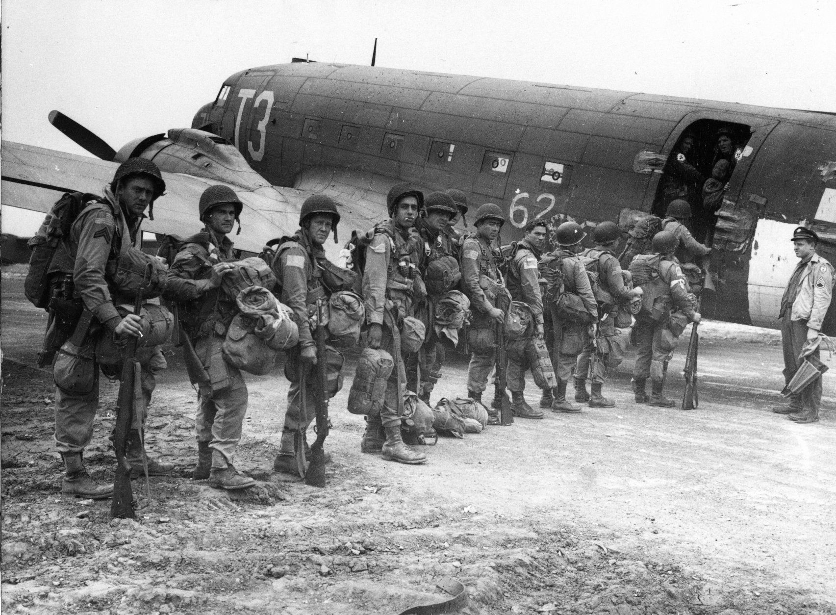 """Allied paratroopers entering one of the huge transports before taking off on the assault on German occupied Holland during """"Operation Market Garden""""  Sept. 17, 1944. (AP Photo/British Official Photograph)"""