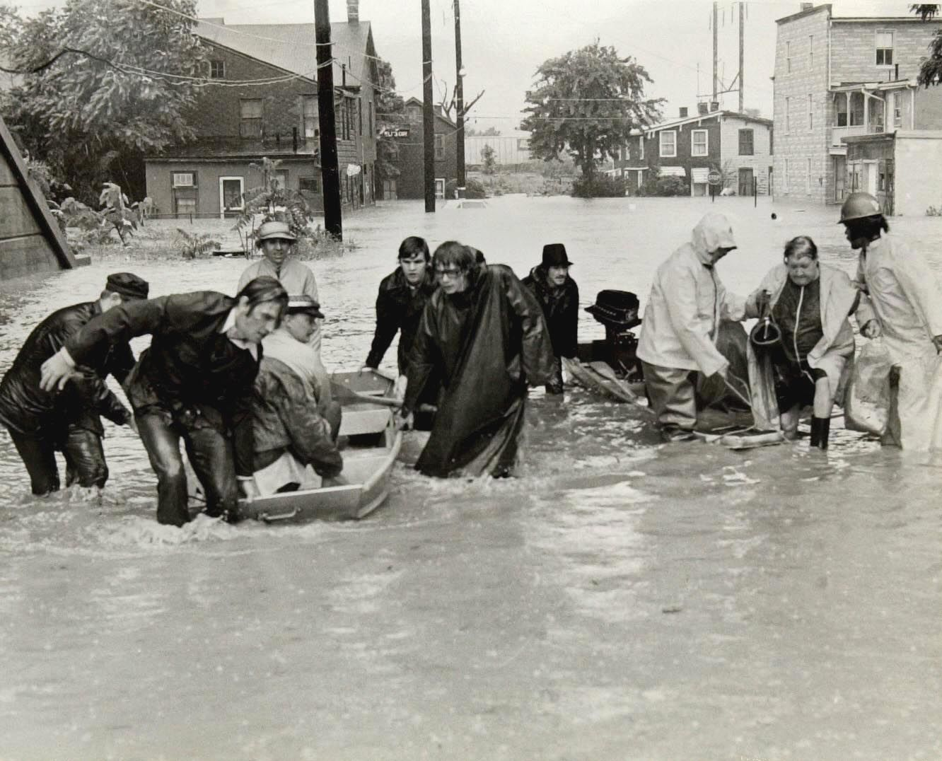 ** ADVANCE FOR SUNDAY, JUNE 16, 2002  FILE ** This June 23, 1972 file photo shows people being rescued by boat from their homes to dry ground after  Hurricane Agnes forced the Susquehanna River to overflow its banks causing heavy flooding in  Harrisburg, Pa. (AP Photo/Paul Vathis, File)