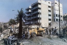 Scene looks toward the wreckage of the American Embassy annex, in Christian East Beirut, Lebanon, on Sept. 20, 1984 after a terrorist car bomb had been driven into the area and exploded, killing 23 persons and injuring more than 60 others. (AP Photo/Zouheir Saade)