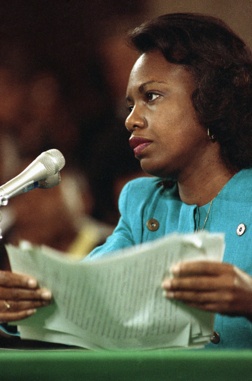 University of Oklahoma law professor Anita Hill straightens papers after making her opening statement to the Senate Judiciary Committee on Capitol Hill in Washington, Friday, Oct. 11, 1991. Hill testified that Supreme Court nominee Judge Clarence Thomas repeatedly would ?use work situations to discuss sex.? (AP Photo/Greg Gibson)
