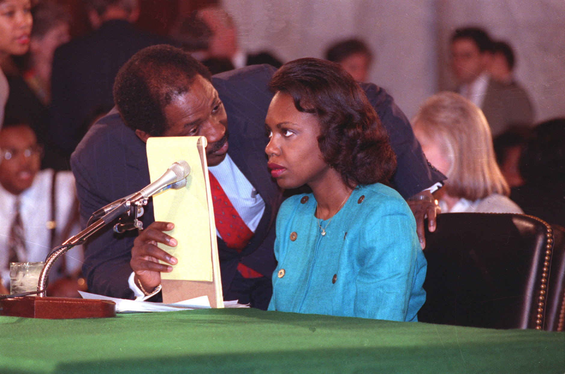 University of Oklahoma law professor Anita Hill receives councel from Charles Ogeltree while testifying before the Senate Judiciary Committee on Capitol Hill in Washington, D.C., Friday, Oct. 11, 1991.  (AP Photo/Greg Gibson)