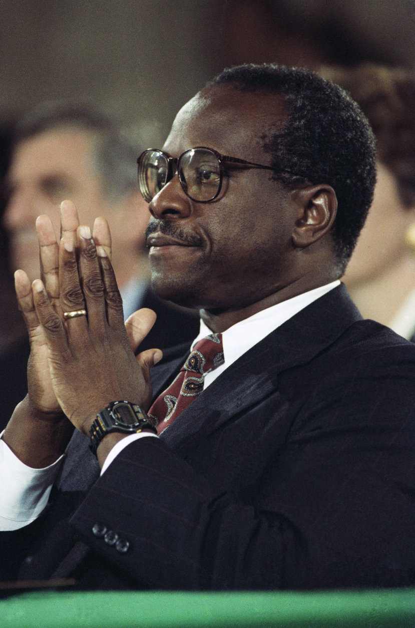 """Judge Clarence Thomas pauses during testimony before the Senate Judiciary Committee on Capitol Hill in Washington, Oct. 11, 1991. A calm and resolute Thomas categorically denied Anita Hill's accusations of sexual harassment and told a tense session of the committee, """"confirm me if you want,"""" but that """"no job is worth"""" what he has been through. (AP Photo/Greg Gibson)"""