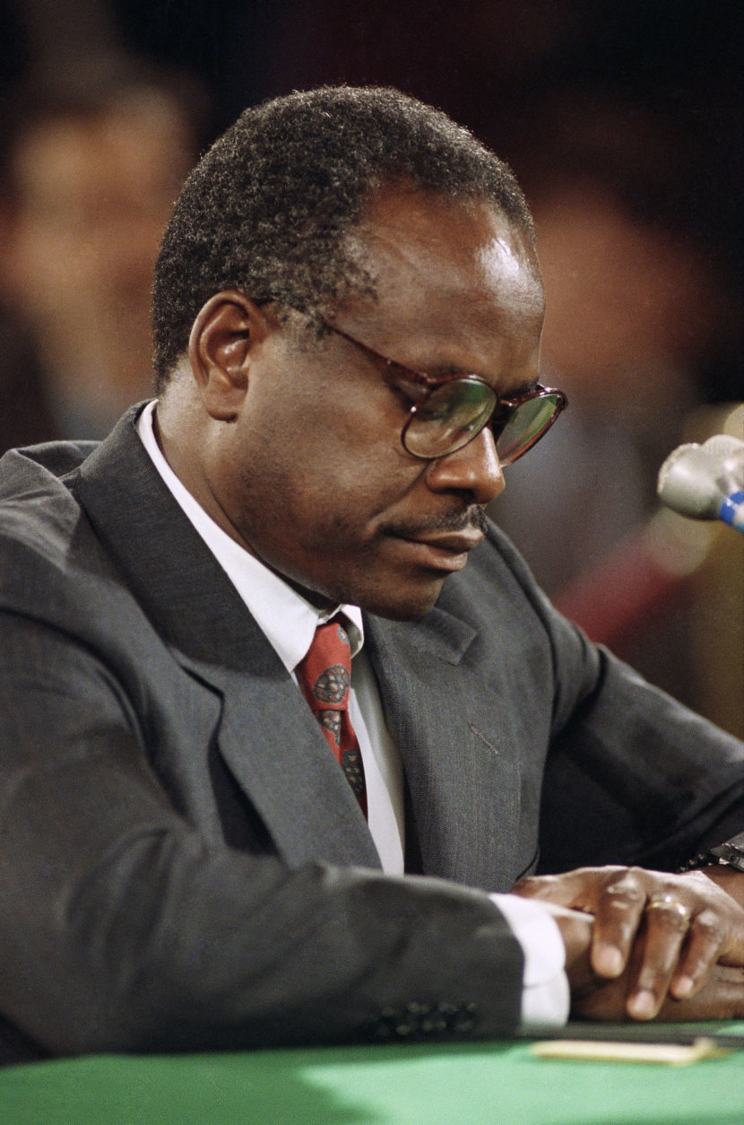 Judge Clarence Thomas pauses during testimony before the Senate Judiciary Committee on Capitol Hill in Washington, Oct. 12, 1991. Thomas flatly denied on Saturday that he had ever discussed pornographic movies with Anita Hill or anyone else in the workplace. (AP Photo/John Duricka)
