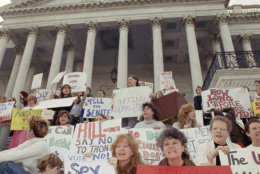 Women protest the nomination of Clarence Thomas for the Supreme Court on the steps of the U.S. Capitol in Washington, Tuesday, Oct. 15, 1991. Thomas gained enough Senate commitments to virtually assure confirmation on Tuesday at night as the heart of his Democratic support stood firm despite Anita Hill?s explosive charges of sexual harassment. (AP Photo/Ron Edmonds)