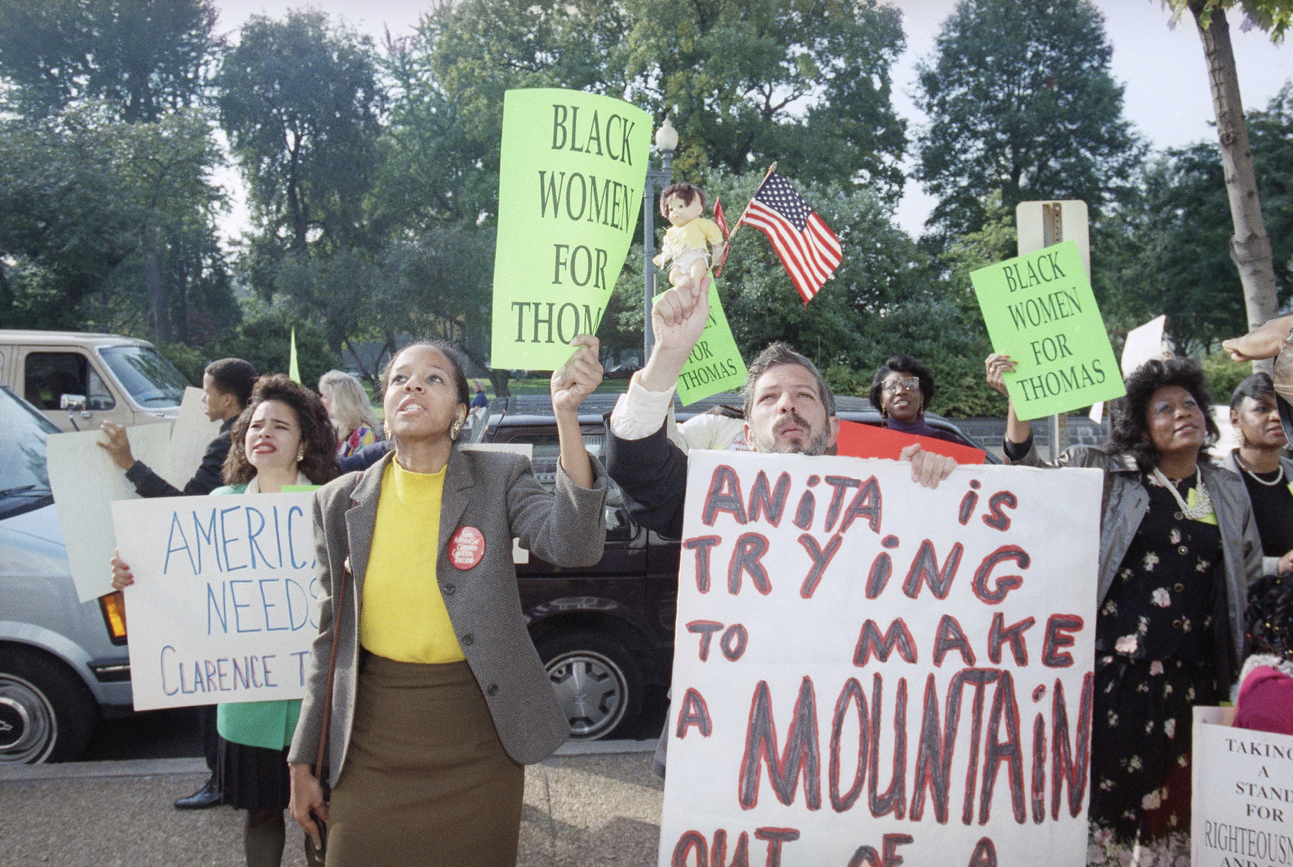 Demonstrators on Capitol Hill yell toward the Russell Senate Office Building in Support of Supreme Court nominee Clarence Thomas in Washington, Oct. 15, 1991 as the Senate debated the Thomas nomination. The confirmation vote is expected on Tuesday. (AP Photo/Ron Edmonds)