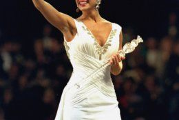 """Miss America 1995 Heather Whitestone, the former Miss Alabama, walks down the runway and signs """"I Love You"""" to the crowd after she won the 74th annual pageant in the Atlantic City Convention Hall Saturday, September 17, 1994. (AP Photo/Tom Costello)"""