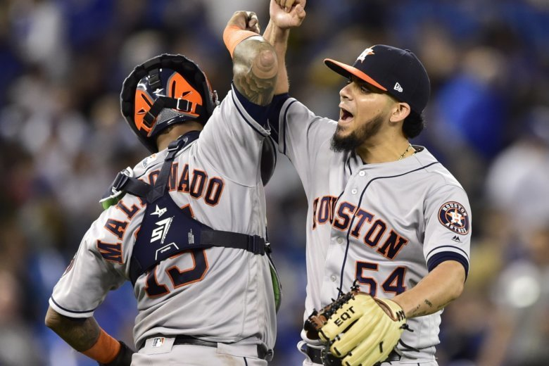 35c685cc8 Houston Astros relief pitcher Roberto Osuna (54) celebrates with catcher  Martin Maldonado (15) after the Astros defeated the Toronto Blue Jays in a.