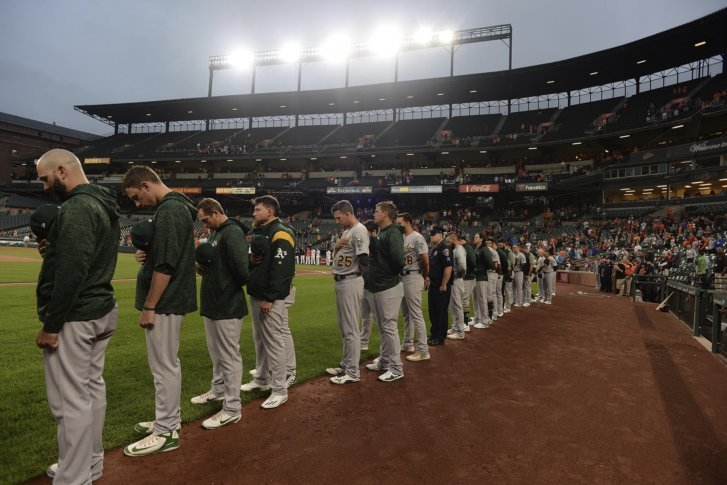 b3ba696e The Oakland Athletics stand for a moment of silence in remembrance of the  Sept. 11th terror attacks before playing the Baltimore Orioles in a  baseball game, ...