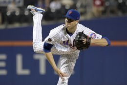 New York Mets pitcher Jacob deGrom delivers the ball to the Atlanta Braves during the first inning of a baseball game Wednesday, Sept. 26, 2018, in New York. (AP Photo/Bill Kostroun)