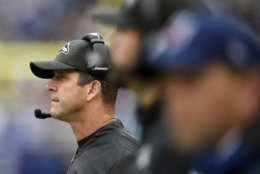 Baltimore Ravens head coach John Harbaugh, left, watches the first half of an NFL football game against the Denver Broncos, Sunday, Sept. 23, 2018, in Baltimore. (AP Photo/Nick Wass)