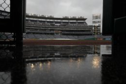 Rain falls on Nationals Park during a rain delay of a baseball game between the Washington Nationals and the Chicago Cubs, Sunday, Sept. 9, 2018, in Washington. (AP Photo/Carolyn Kaster)