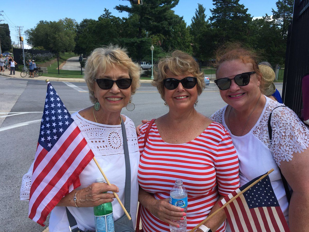 Three best friends were among those who lined the street outside the Naval Academy to pay a final tribute to Sen. McCain. (WTOP/Liz Anderson)