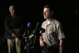 Lt. Eli Cory with Fairfax County police spoke with reporters on Wednesday, Sept. 5, 2018, near the scene where three people were found dead in Herndon, Virginia. (WTOP/Michelle Basch)