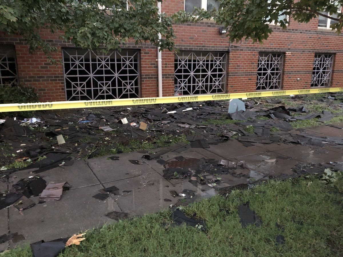 Charred debris is scattered around the senior apartment complex Thursday morning. Reports are that the fire alarms didn't work. (WTOP/Nick Iannelli)