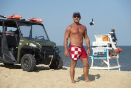 Tim Ferry stands guard near a lifesaver post on Fenwick Island beach, which he'll be leaving at the end of the season. (AP/Jason Minto)