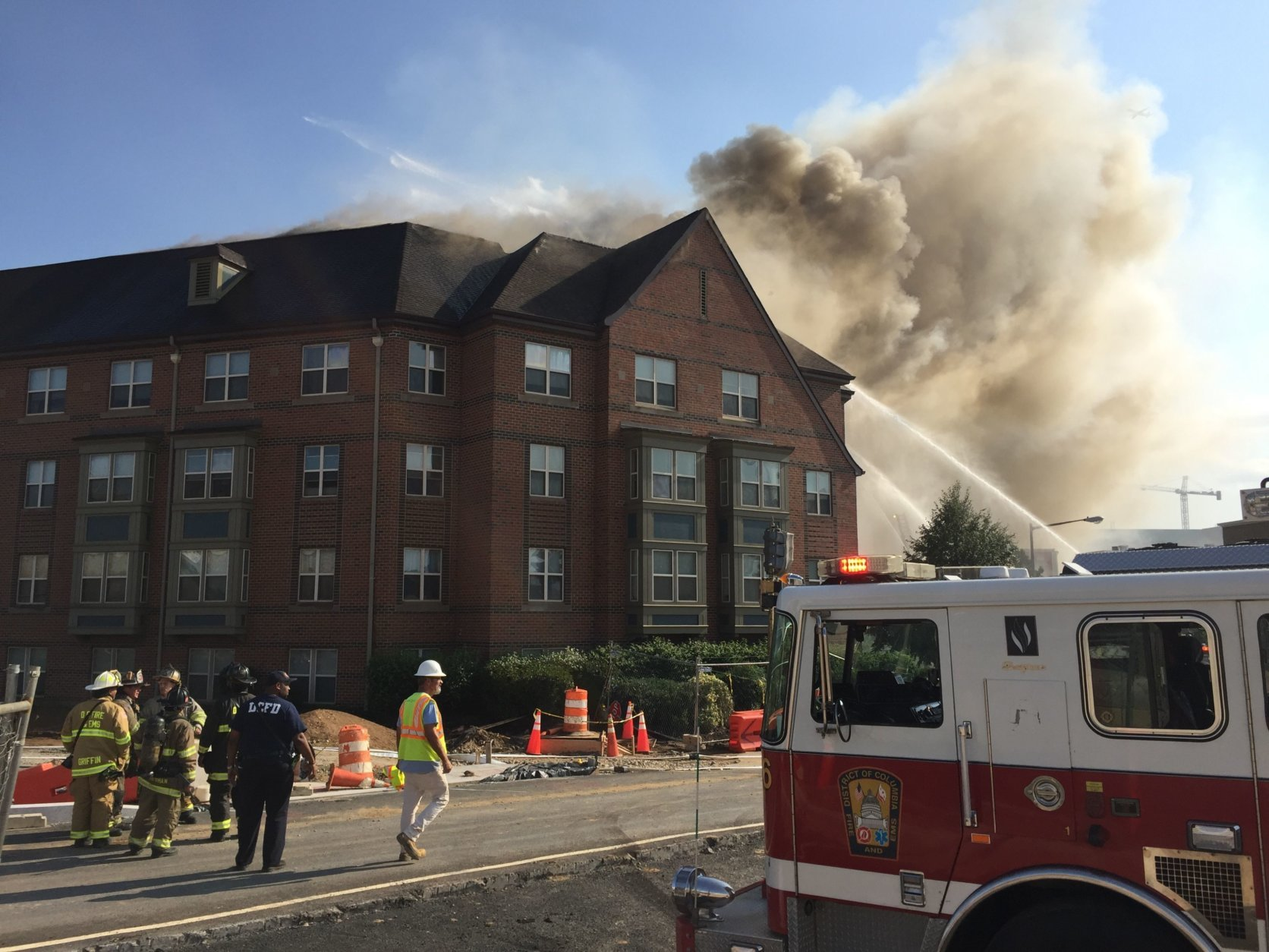 Multiple fire companies battle a two-alarm fire in a five-story apartment building in Southeast D.C. that houses senior citizens. (Courtesy Nicky Sundt)