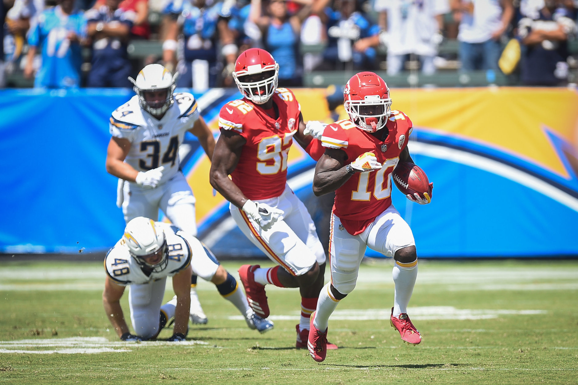 CARSON, CA - SEPTEMBER 09: Wide receiver Tyreek Hill #10 of the Kansas City Chiefs runs the ball for a touchdown in the first quarter against the Los Angeles Chargers at StubHub Center on September 9, 2018 in Carson, California. (Photo by Kevork Djansezian/Getty Images)