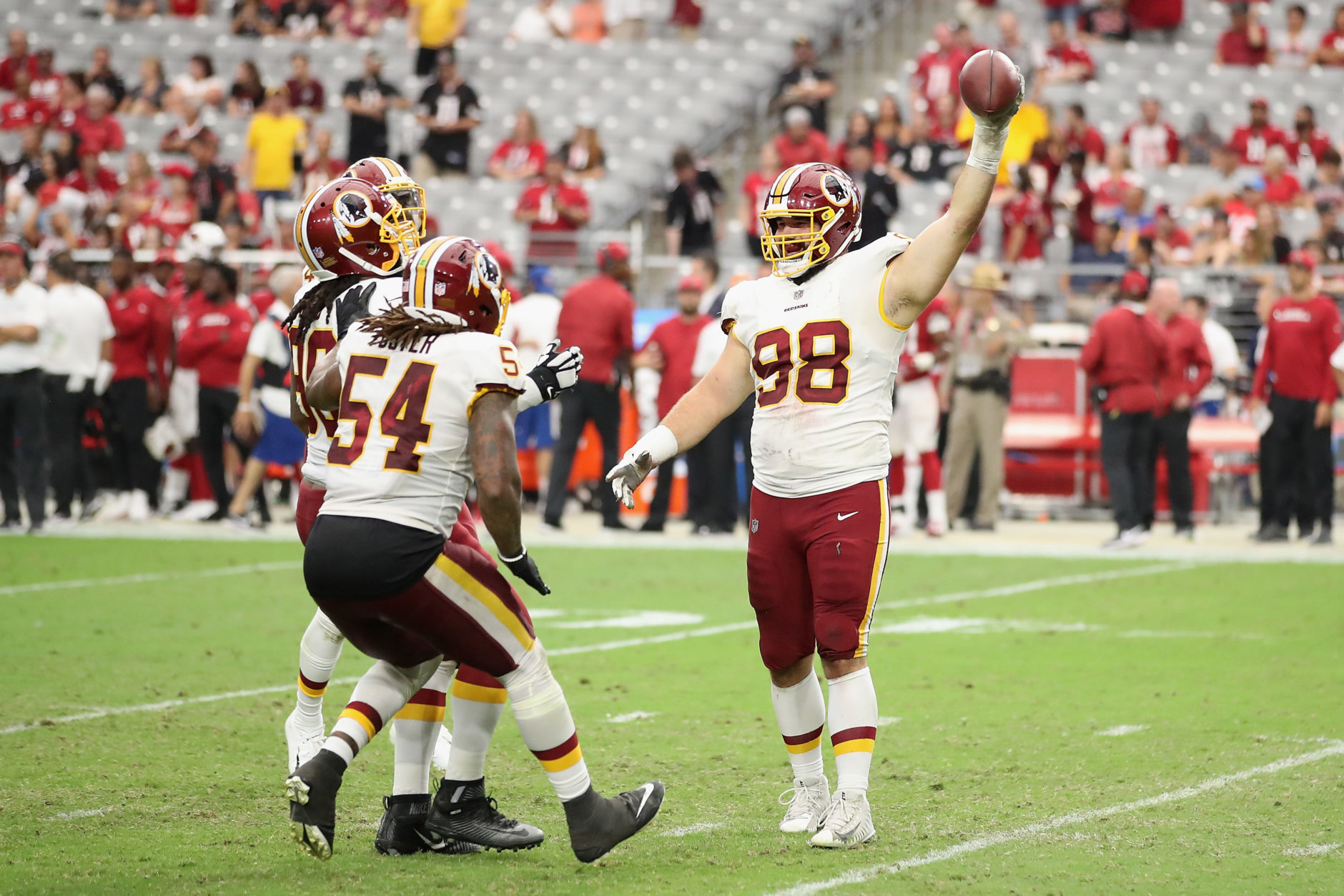 GLENDALE, AZ - SEPTEMBER 09:  Defensive tackle Matthew Ioannidis #98 of the Washington Redskins celebrates with linebacker Mason Foster #54 after a turnover during the final moments of the NFL game against the Arizona Cardinals at State Farm Stadium on September 9, 2018 in Glendale, Arizona.  The Redskins defeated the Cardinals 24-6.  (Photo by Christian Petersen/Getty Images)